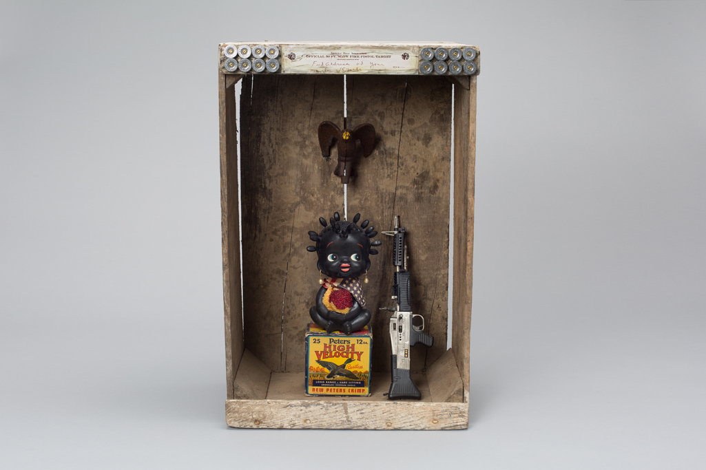 Shadow Box with Black Nodder Doll as an NRA target