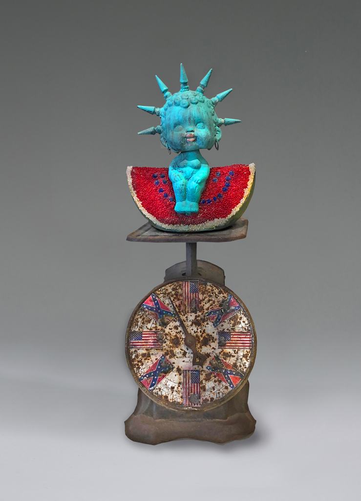 Lady Liberty Realness - Black Nodder Doll on Watermelon on Scale - Racial Justice piece by Willie Little